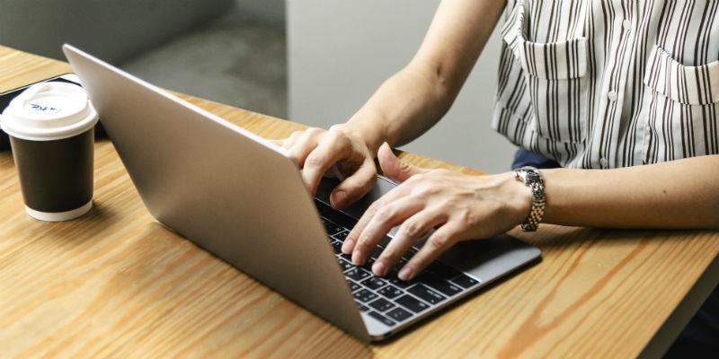 Woman writing website metadata