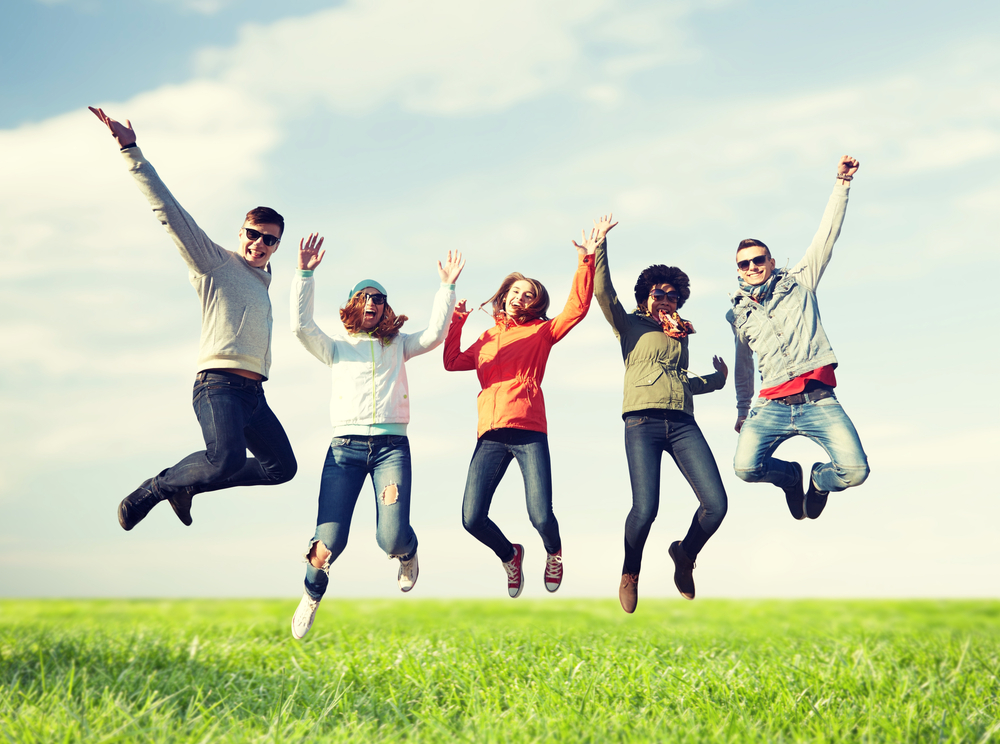 people jumping with happiness