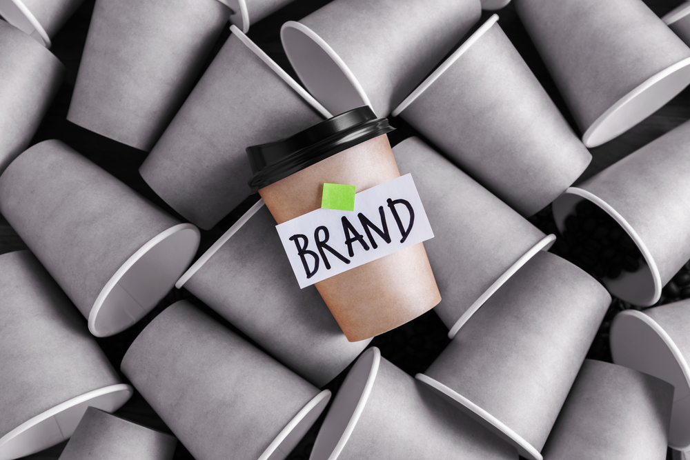 Coffee cup showing the word brand
