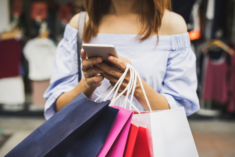 Ecommerce - person doing online shopping on phone