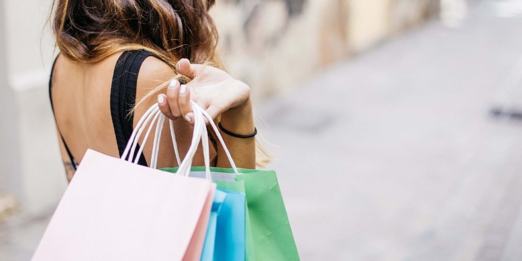 Woman with shopping bags after using e-commerce website