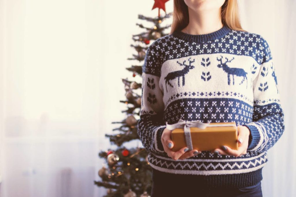 Woman wearing Christmas jumper