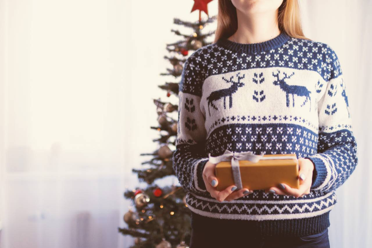 Woman wearing Christmas jumper