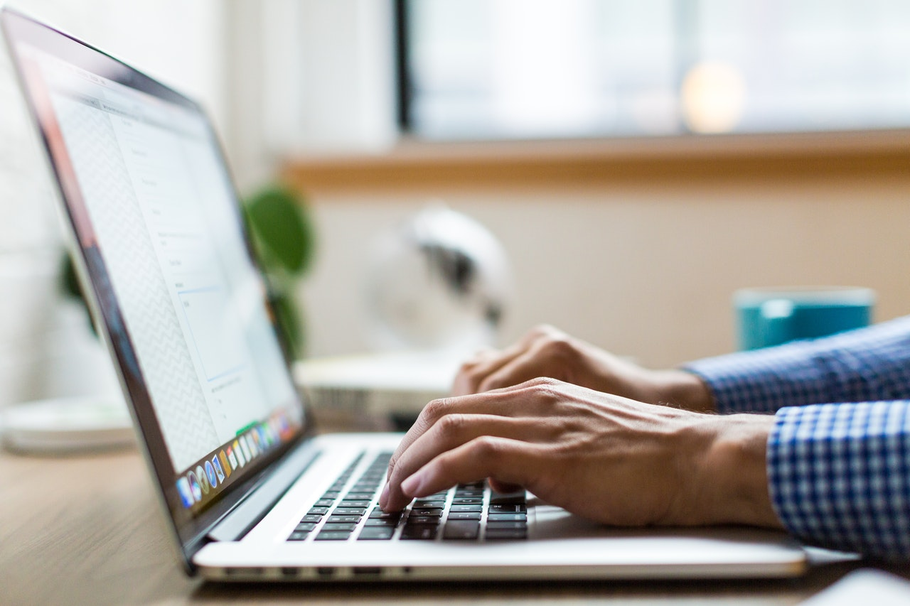 Person typing text in WordPress website for SEO experiment